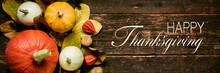 Autumn Harvest And Holiday Still Life. Happy Thanksgiving Banner. Selection Of Various Pumpkins On Dark Wooden Background. Autumn Vegetables And Seasonal Decorations.