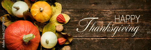 Fototapeta Autumn Harvest and Holiday still life. Happy Thanksgiving Banner. Selection of various pumpkins on dark wooden background. Autumn vegetables and seasonal decorations. obraz