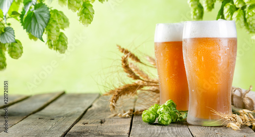Deurstickers Bier / Cider Beer and ingredients hops, wheat, barley on wood background, copy space
