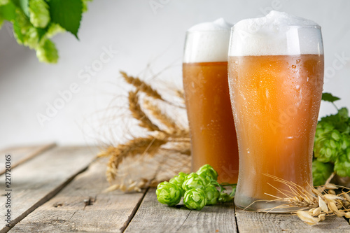 Fotobehang Bier / Cider Beer and ingredients hops, wheat, barley on wood background, copy space