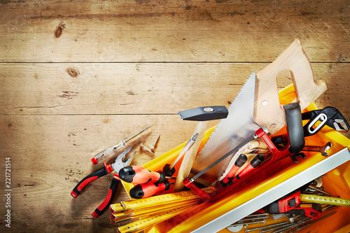 Fototapeta Overflowing tool box with assorted hand tools obraz