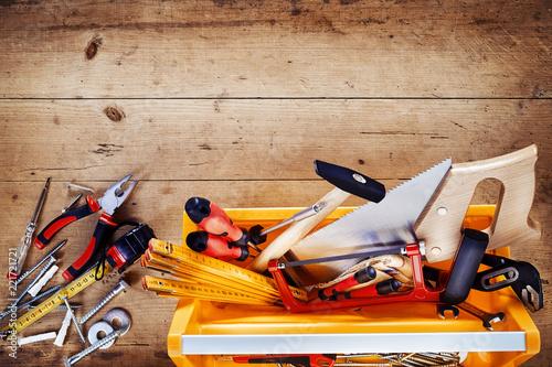 Fototapeta Top down view of hand tools in a tool box obraz