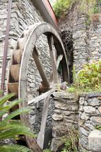 An Old Waterwheel Still Preserved In Manarola. Italy
