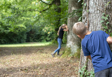Kids Playing Hide And Seek In The Forrest
