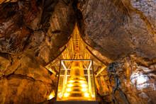 Golden Pagoda In Cave At Wat Phra Sabai, Lampang, Thailand.