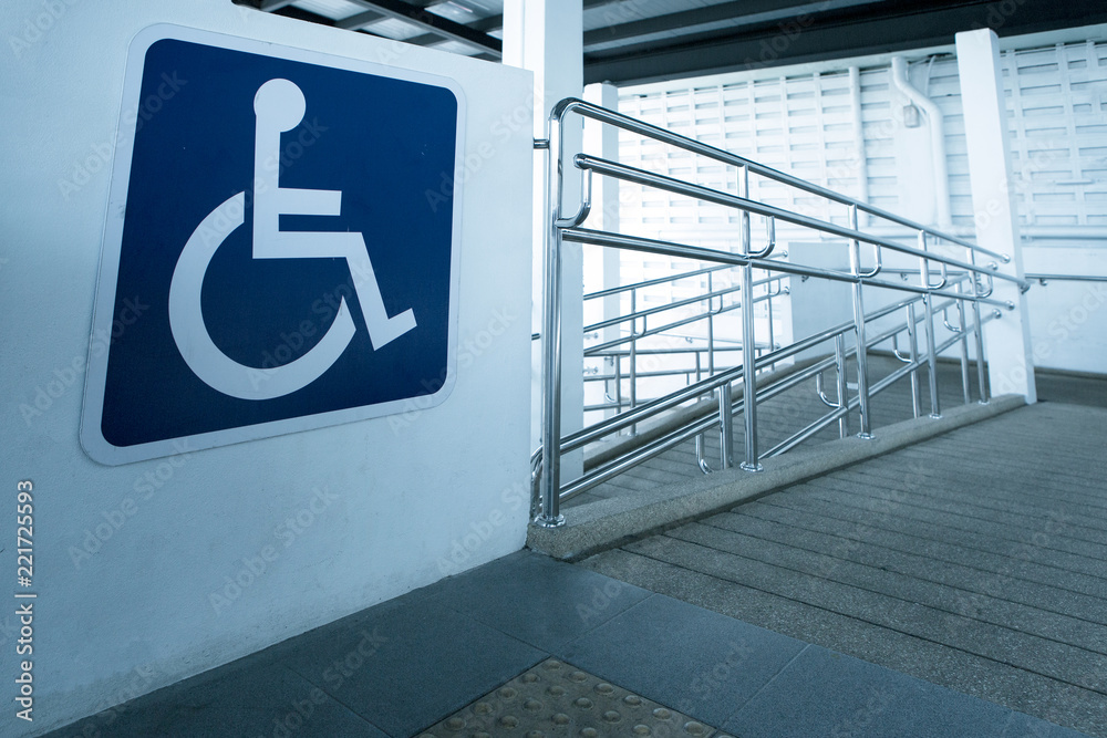 Fototapety, obrazy: Concret ramp way with stainless steel handrail with disabled sign for support wheelchair disabled people.