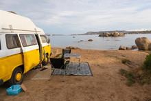 Retro Minivan Car On Camping Spot On Beach Near Palau, Costa Smeralda, Sardinia, Italy. Summer Holidays, Road Trip, Vacation And Travel And Concept.