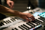 close up of hands playing keyboard