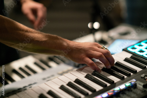 close up of hands playing keyboard - 221739525