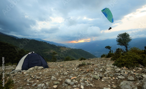 Camping Tent and Paraglider at the Summit