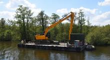 Large Mechanical Digger On Floating Pontoon For River Maintenance
