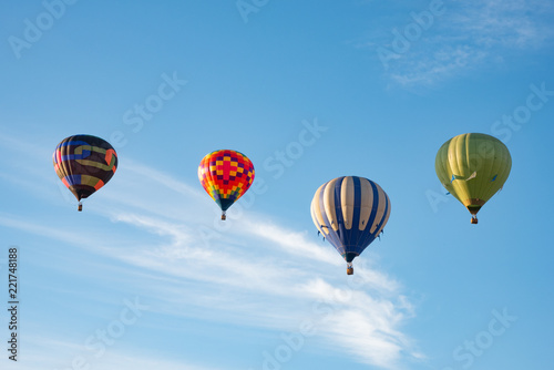 Poster Montgolfière / Dirigeable Four hot air balloons lined up in the sky