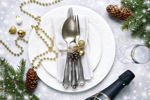 Christmas table place setting on a light slate,stone or concrete backdrop.Christmas holiday background.Top view.