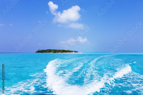 Waves behind the speedy boat of fast moving, rear view