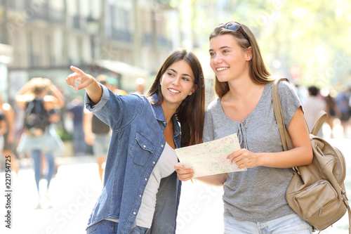 Girl helping to a tourist who asks direction