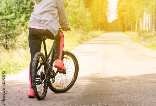 Fotobehang Fietsen Woman with a mountain bicycle