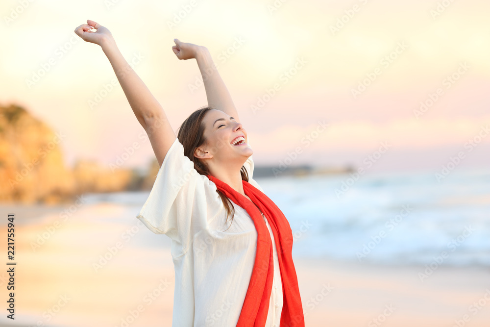Fototapety, obrazy: Excited woman celebrating sunset raising arms