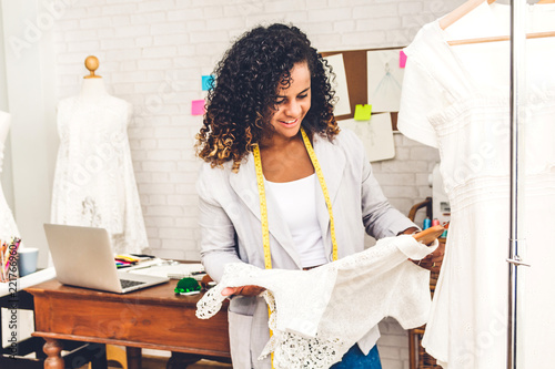 Smiling African American Black Woman Fashion Designer Standing Working And Holding Dress At Workshop Studio Buy This Stock Photo And Explore Similar Images At Adobe Stock Adobe Stock