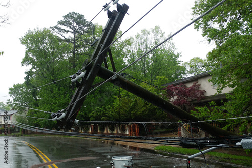 Aluminium Prints Storm transformer on a pole and a tree laying across power lines over a road after Hurricane moved across