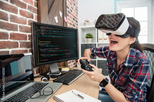 wearing virtual reality goggles and playing game Tablou Canvas