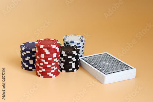 фотография  The pile of casino chips and a pile of cards.