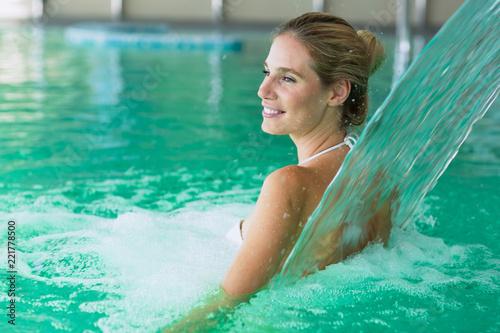 Obraz Beautiful attractive woman enjoying time in pool - fototapety do salonu