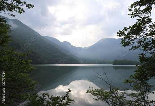 Keuken foto achterwand Bergen Scenery of lake and water reflection with mountain and cloudy sky background in the evening.