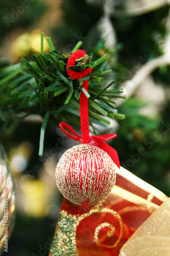 Fotografia  Shiny Christmas and New Year decorations golden and s red colors on a fir tree