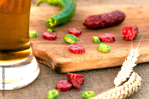 In de dag Bier / Cider beer in a glass, sausage, meat snack on table