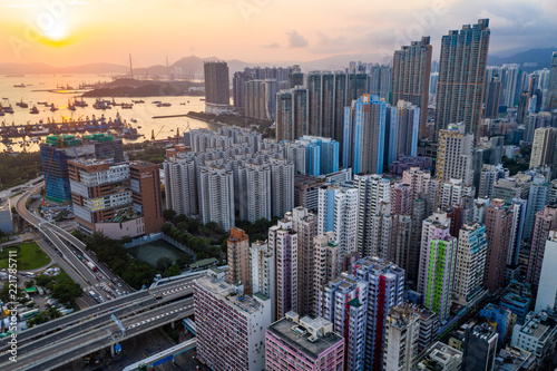 Fotografia  Drone fly over Hong Kong city in the evening