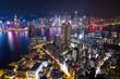 Drone fly over Hong Kong city at night