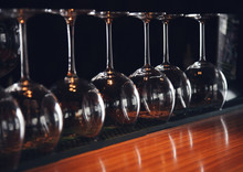 Wine Glasses Stand Upside Down On The Bar In The Restaurant, An Abstract Bar Image, An Image With Retro Toning