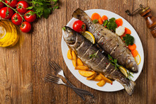 Grilled Whole Trout. Served With Baked Potatoes.