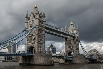 Naklejka Tower bridge, over the river Thames, London, on a cloudy, stormy day