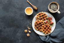 Whole Wheat Waffles With Honey And Figs On Black Concrete Background. Top View, Copy Space For Text