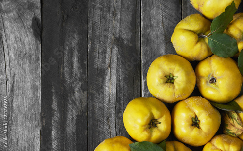 Tableau sur Toile A lot of apple quince  on dark wooden background. top view