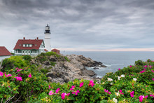Portland Head Light At Summer Cloudy Day And Flowers In Maine, New England.