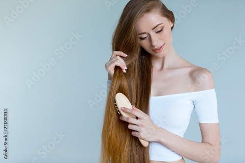 Fényképezés  Beauty close-up portrait of beautiful young woman with long brown hair on white background