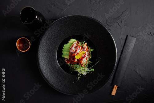 top view of Japanese Ceviche with seafood, avocado and herbs on black plate Wallpaper Mural