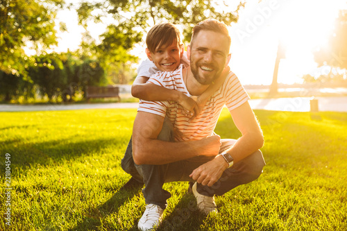 Excited father spending time with his little son at the park
