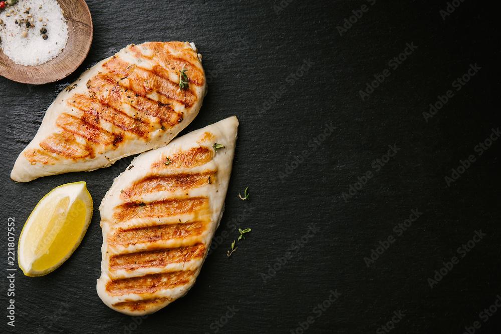 Fototapety, obrazy: Grilled chicken breast served on black slate
