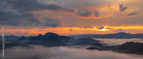 Foto auf AluDibond Lachs wonderful, beautiful sunset in the mountains. The fogs were illuminated by the setting sun