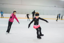 Little Girls Learning To Ice S...