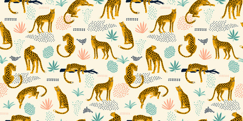 FototapetaVestor seamless pattern with leopards and tropical leaves.