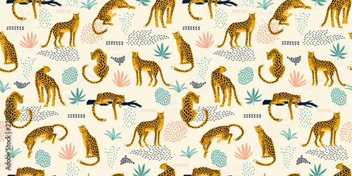 Fototapeta Vestor seamless pattern with leopards and tropical leaves.