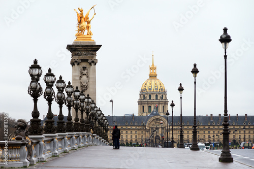 Photo sur Toile Europe Centrale A cloudy day at the Pont Alexandre III and Les Invalides in Paris