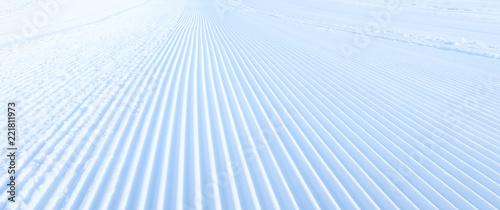 Fotomural Close-up groomed snow at ski resort, slope banner background texture