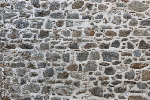 Photo Grey stone wall with mortar