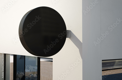 Fotografía  mockup of a rounded sign on exterior wall