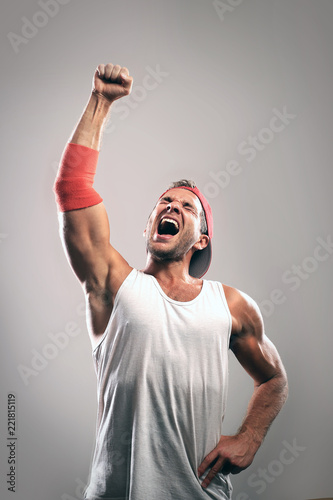 Athlete with a raised hand celebrates victory